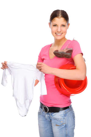 Full isolated studio picture from a young girl with baby clothes photo