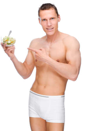 Full isolated studio picture from a young naked man with salad Stock Photo - 9006715
