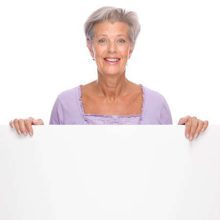 Full isolated portrait of a beautiful and happy senior woman with blank sign Stock Photo - 9164076