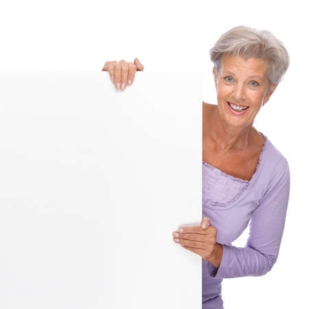 Full isolated portrait of a beautiful and happy senior woman with blank sign Stock Photo - 9165450