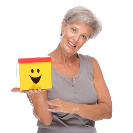 Full isolated portrait of a senior woman with box Stock Photo - 9164044