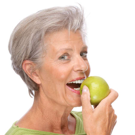Full isolated portrait of a active senior with apple Stock Photo