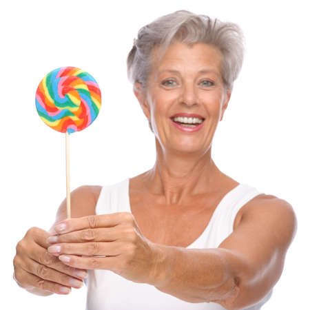 Full isolated portrait of a senior woman with lolly Stock Photo - 9249325