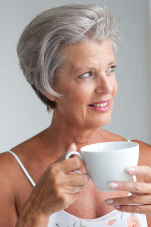 Portrait of a active senior woman with cup photo