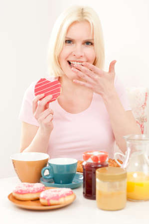 Young and beautiful woman having breakfast in the morning  photo