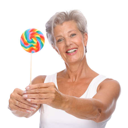 Full isolated portrait of a senior woman with lolly Stock Photo - 9571450