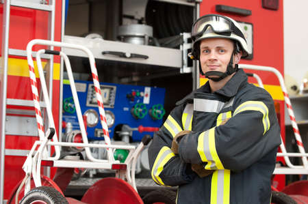 Picture from a young and successful firefighter at work Stock Photo