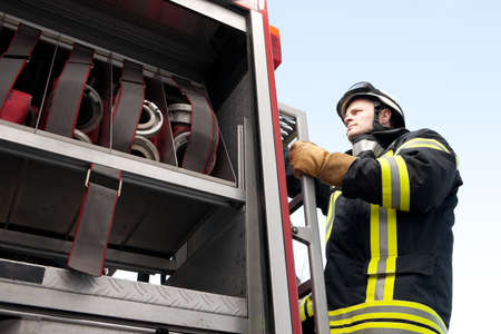 Picture from a young and successful firefighter at work Stock Photo - 9732224