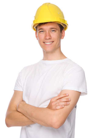 yellow hard hat: Full isolated studio picture from a young craftsman