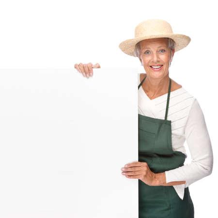 delantal: Retrato de cuerpo aislado de un jardinero veterano