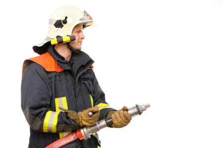 fire fighter: Picture from a young and successful firefighter at work Stock Photo