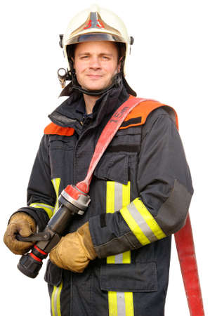 fireman helmet: Picture from a young and successful firefighter at work Stock Photo