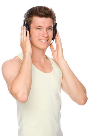 Full isolated portrait of a  smiling young man with headphones photo