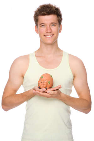 Full isolated portrait of a  smiling young man with piggybank Stock Photo - 10122172