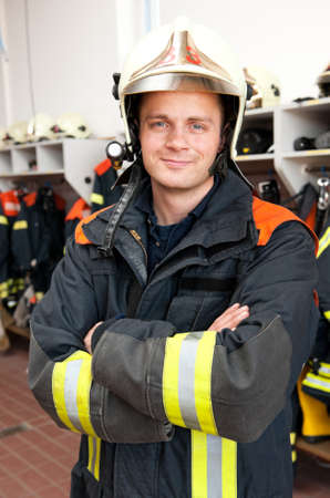 fire helmet: Picture from a young and successful firefighter at work Stock Photo