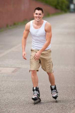 roller skate: Young and smiling man skating