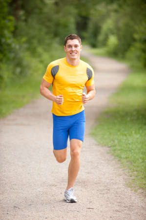 Young and smiling jogger  in the park