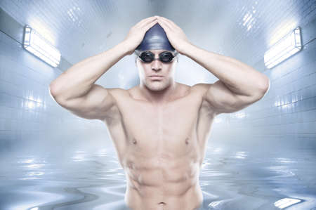 swimmer: Young swimmer standing in blue water