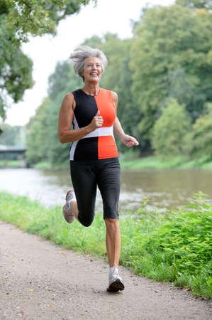Active senior woman running Stock Photo