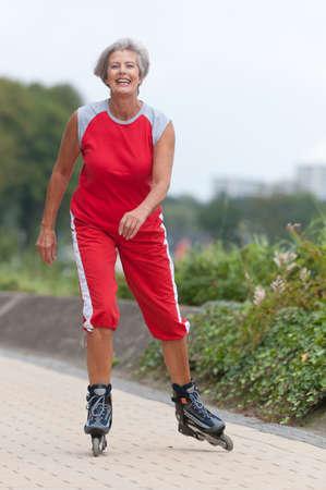 rollerblading: Active senior woman skating