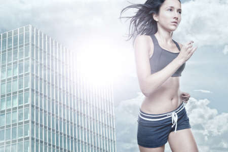 Young woman running in front of urban style