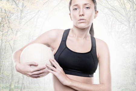Young woman with volleyball photo