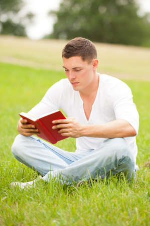 Young man with book in the park
