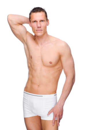 Full isolated studio picture from a young naked man with underwear photo