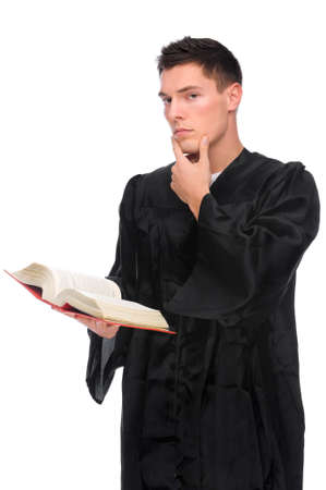 law suit: Full isolated studio picture from a young judge (lawyer) with statute book Stock Photo