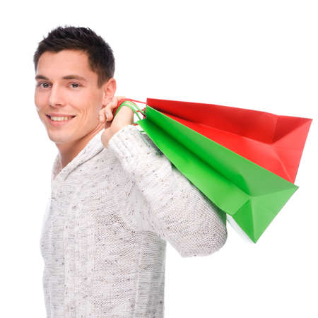 Full isolated studio picture from a young man with shopping bags photo