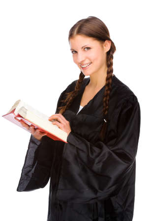 professional practice: Full isolated studio picture from a young judge (lawyer) with statute book Stock Photo
