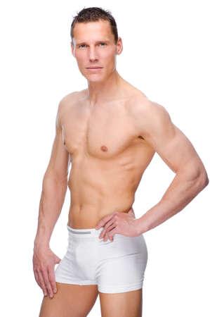 hombre desnudo: Panorama completo estudio aislado de un hombre joven desnudo con la ropa interior Foto de archivo