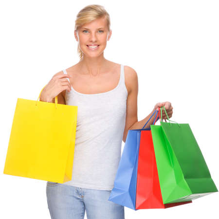 Full isolated portrait of a beautiful  woman with shopping bags photo