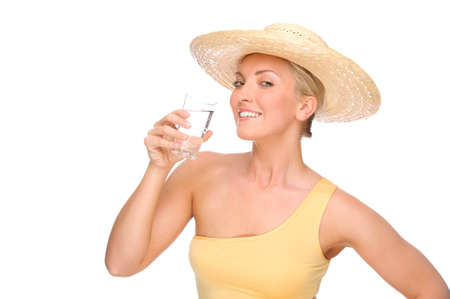 Full isolated portrait of a beautiful woman with glass of water photo