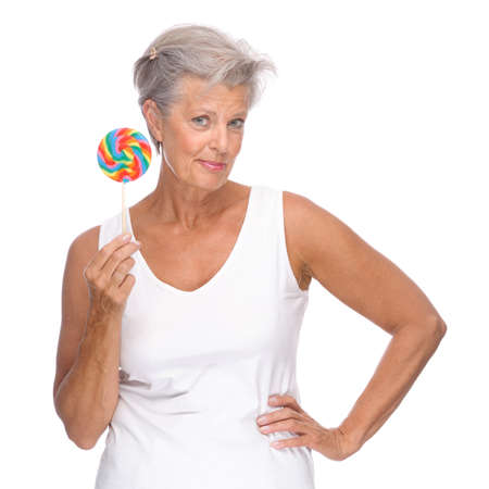 Full isolated portrait of a senior woman with lolly Stock Photo - 13310209