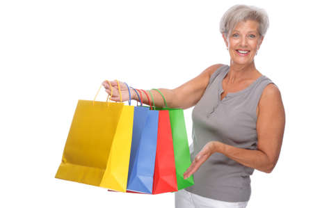 Full isolated portrait of a senior woman with shopping bags photo