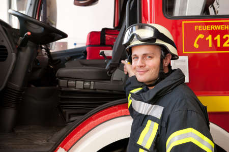 Picture from a young and successful firefighter at work Zdjęcie Seryjne
