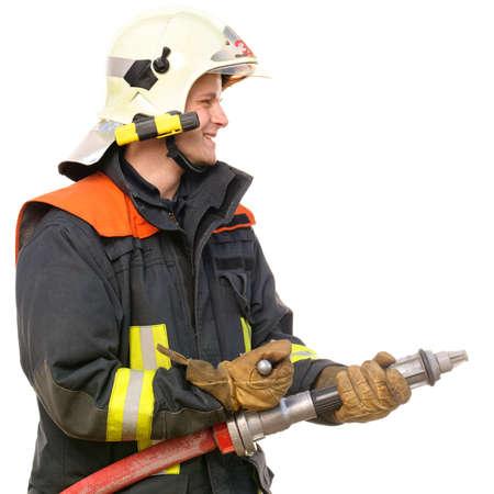 bombero de rojo: Foto de un bombero joven y exitoso en el trabajo