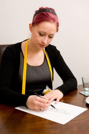 dressmaker: Young dressmaker in her studio