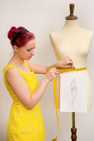 ladies bust: Young dressmaker in her studio