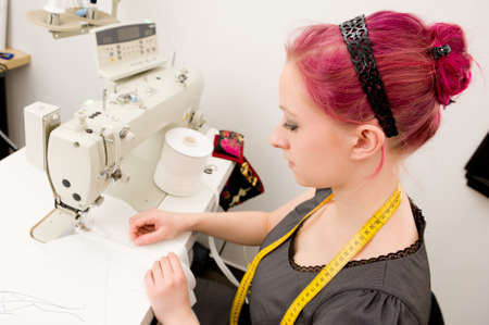 Dressmaker with sewing machine in her studio photo