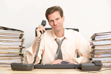 Middle aged businessman in his office Stock Photo - 13309758