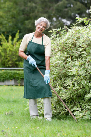 Active senior woman in the garden Stock Photo - 13309248