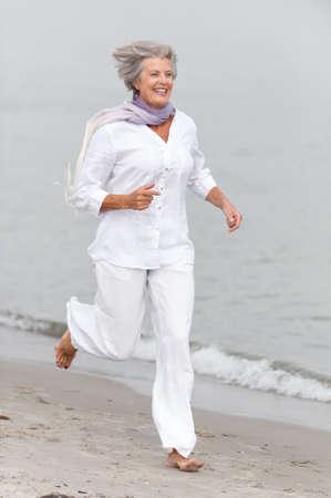sea sports: Active and happy senior woman