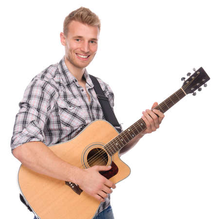 Full isolated studio picture from a young man with guitar photo