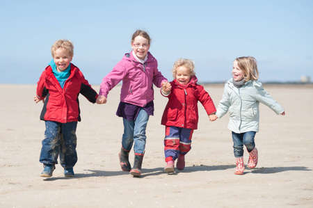 Children running at the beach photo