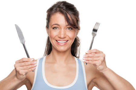 young knife: Full isolated woman with fork and knife Stock Photo
