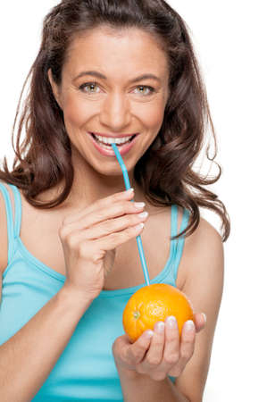 Full isolated woman with straw and orange photo