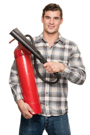 Smiling young man with extinguisher in front of white background