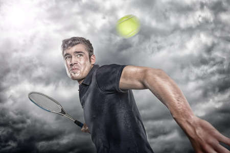 Tennis player in front of dramatic sky